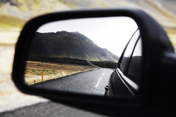 A leave manager checks their side mirror and considers the importance of peripheral vision in leave management