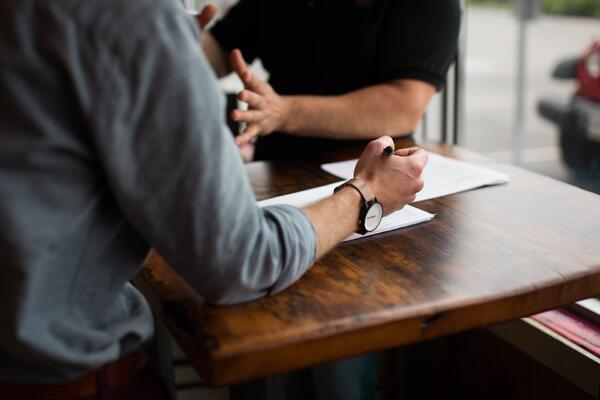 An HR manager gathers information from stakeholders before determining how to accommodate