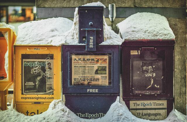 Newspaper boxes demonstrating that paid family leave is gaining a global and national focus