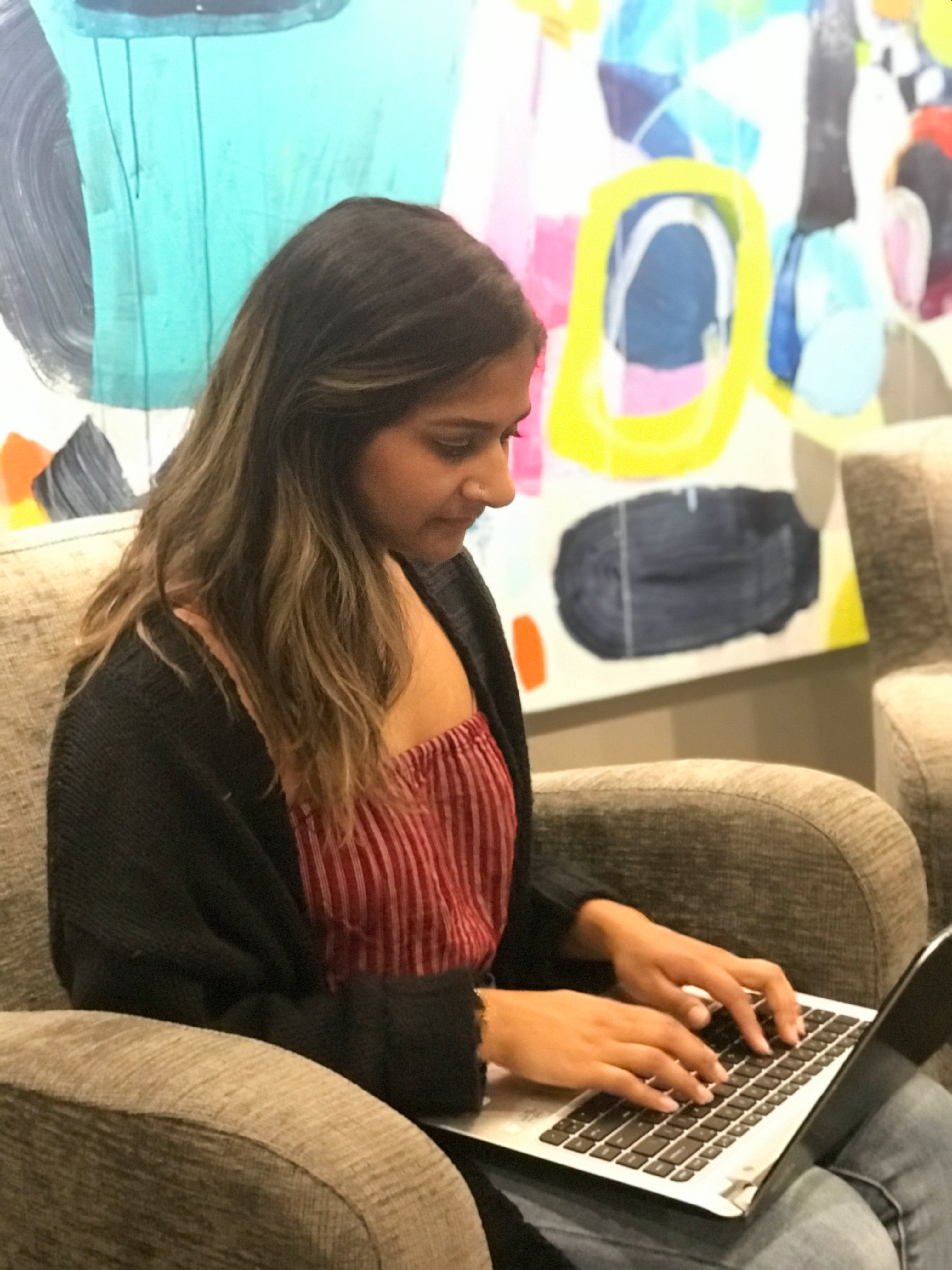 Shahlla Karmali- Marketing Coordinator, working on a blog post