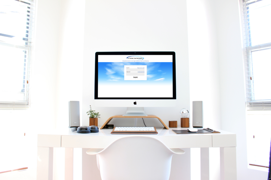 A desk that has accommodations for employee with Presagia's homepage