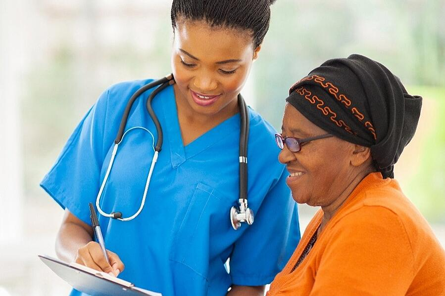 A nurse who works for AtlantiCare explaining the status of a test to her patient