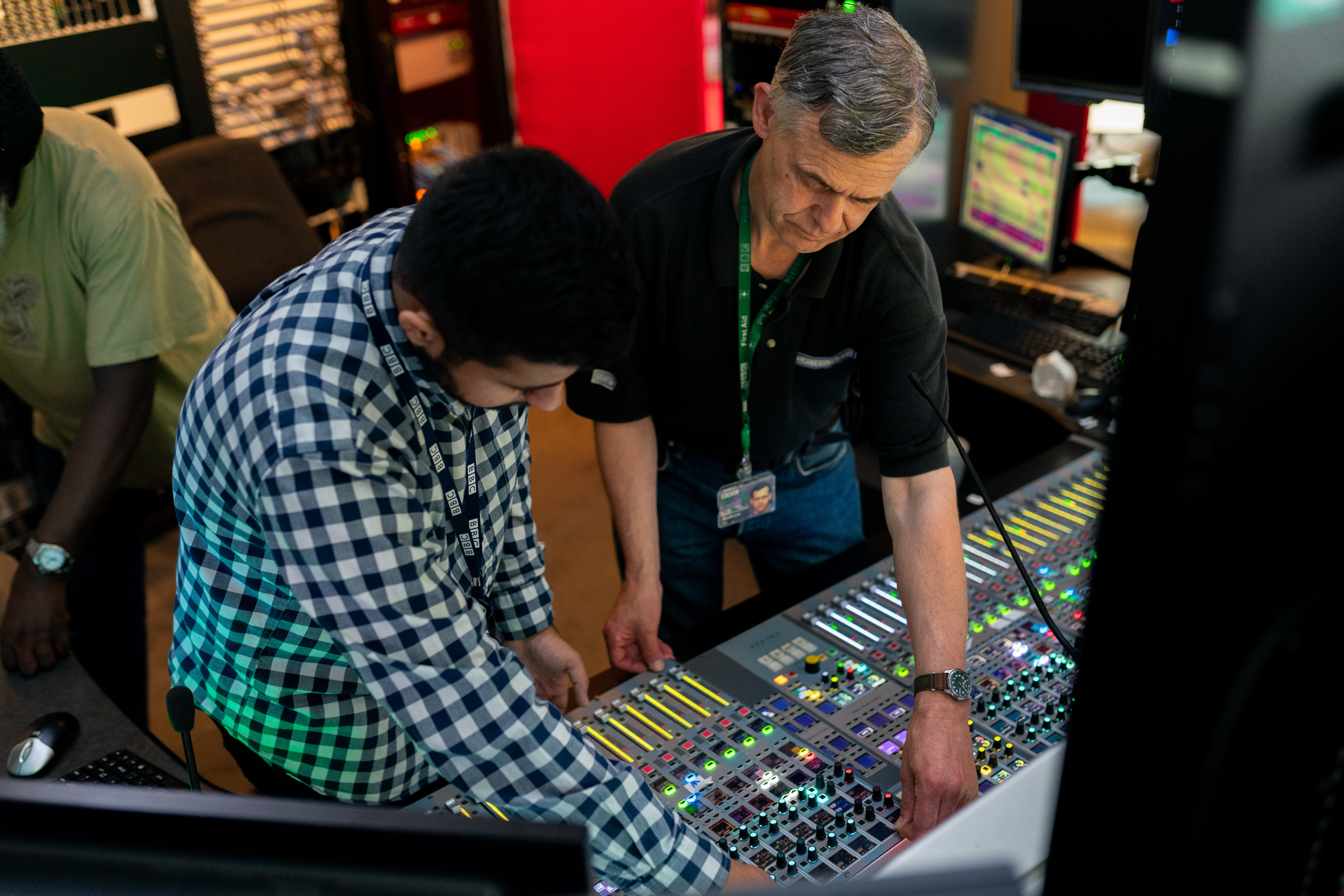 Two sound engineers who work for Emmis Communications