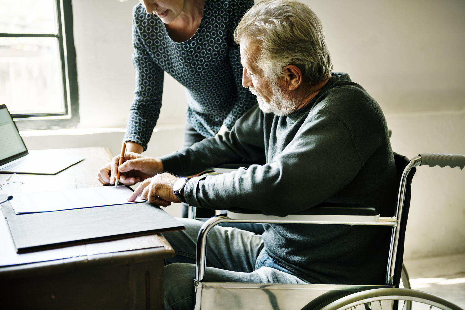 Case manager assists employee in a wheelchair who needs an ADA accommodation