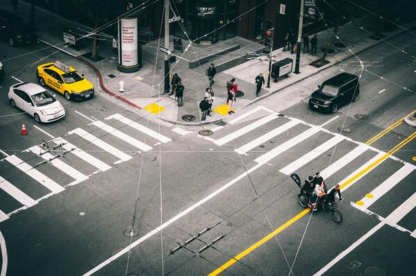 People stand at an intersection assessing the overlap of the FMLA and ADA